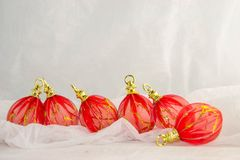New Year`s decorations, rustic,  red, gold and white. Christmas decoration with red decorations with golden details on a white background Stock Image