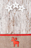 Christmas decoration with red deer and burlap Royalty Free Stock Photos