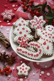 Christmas decoration on a red fabric background. Christmas cookies handmade royalty free stock photography
