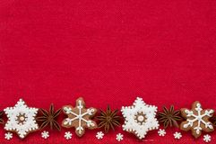 Christmas decoration on a red fabric background. Christmas cookies in the shape of snowflakes handmade stock photos