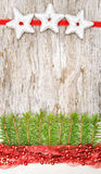Christmas decoration with red garland, canvas and fir branch Stock Photo