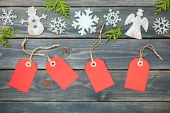 Christmas decoration and red gift tags. On wooden background Royalty Free Stock Images