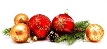 Christmas decoration red golden yellow balls with fir cones and Royalty Free Stock Photography