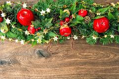 Christmas decoration red green gold over wooden background Stock Photo