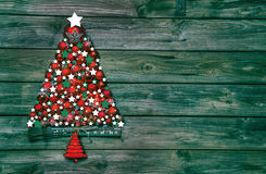 Christmas decoration in red and green: tree of balls on wooden b Stock Photo