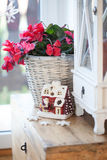 Christmas decoration- red house. And flowers Stock Photography