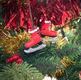 Christmas decoration of an red Ice Skate on a tree Royalty Free Stock Photography