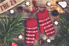 Christmas decoration with red knitted mittens, pine tree twigs and xmas toys Stock Images