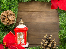 Christmas decoration with red lantern, pine cones and poinsettia Royalty Free Stock Images