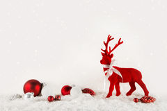Christmas decoration: red reindeer on wooden white background. Royalty Free Stock Photography