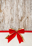Christmas decoration with red ribbon, bow and canvas Stock Photo
