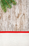 Christmas decoration with red ribbon, canvas and fir branch Royalty Free Stock Image