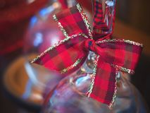 Christmas decoration, red ribbon on glass royalty free stock image