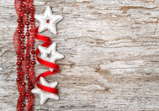 Christmas decoration with red ribbon and silver stars Stock Images