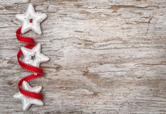Christmas decoration with red ribbon and silver stars Royalty Free Stock Photo