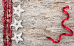 Christmas decoration with red ribbon and silver stars Royalty Free Stock Images