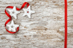 Christmas decoration with red ribbon and silver stars Stock Photography