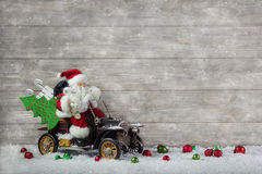 Christmas decoration: Red santa claus in hurry to buy christmas Royalty Free Stock Images