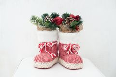 Christmas decoration: red Santa`s boot, fir tree, pine cones and christmas toys stock photography