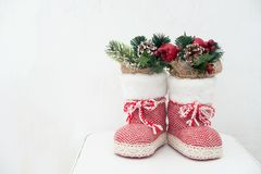 Christmas decoration: red Santa`s boot, fir tree, pine cones and christmas toys royalty free stock photography