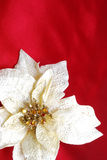 Christmas decoration on red sateen. With white flower stock images