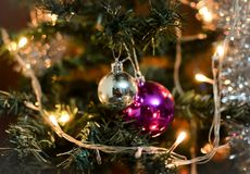 Red and Silver Christmas balls on tree. Christmas Decoration, Red and Silver Christmas balls on tree with lights royalty free stock images