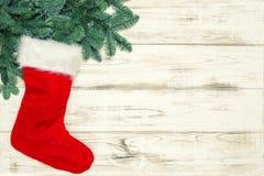 Christmas decoration red sock green pine tree branches vintage. Christmas decoration red sock and green pine tree branches. Vintage style toned picture stock image