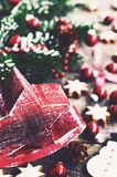 Christmas decoration with red star, snowman, red balls and gingerbread cookies Royalty Free Stock Photos