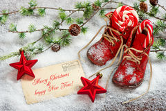 Christmas decoration red stars and antique baby shoes Royalty Free Stock Photography