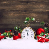 Christmas decoration red stars, baubles and golden clock Stock Photos