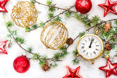 Christmas decoration red stars, baubles and golden clock Royalty Free Stock Photography
