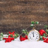 Christmas decoration red stars, baubles and golden clock Stock Image