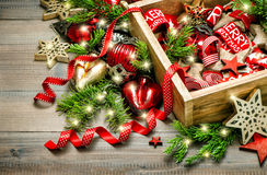 Christmas decoration red stars, baubles, ribbons, candles, light Stock Photo