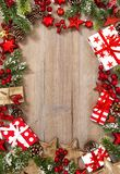 Christmas decoration red stars gifts wooden background Vibrant. Christmas decoration, red stars and gifts on wooden background. Vibrant colors stock image