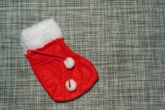 Christmas ornament red stocking on a grey background royalty free stock photography