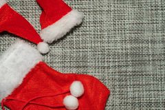 Christmas decoration red stocking and Santa hat on grey background close up stock photos