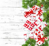 Christmas decoration red white gift boxes flat lay. Christmas decoration red white gift boxes on wooden background. Holidays flat lay royalty free stock image