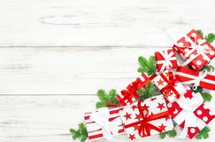 Christmas decoration red white gift boxes wooden background. Christmas decoration red white gift boxes on wooden background royalty free stock images