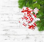 Christmas decoration red white gift boxes wooden background. Christmas decoration red white gift boxes on bright wooden background royalty free stock photography