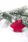 Christmas decoration red and white on snow Royalty Free Stock Images
