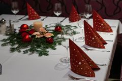 Christmas decoration on a restaurant table. wine glass, red napkins; stock photo