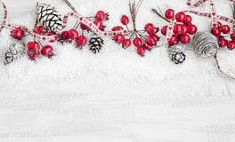 Christmas Decoration Ribbon Frame with Red Berries and Pine Cone Stock Photo