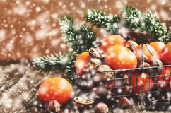 Christmas decoration with ripe tangerines in wire basket Stock Photo