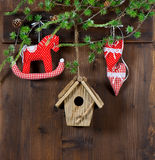 Christmas decoration. rocking horse and red hearts on wooden bac Royalty Free Stock Image