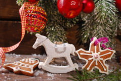 Christmas decoration with rocking horse toy on wooden background Stock Photos