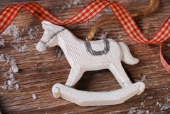 Christmas decoration with rocking horse on wooden background Stock Images