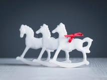 Christmas decoration, rocking horses, porcelain figurine Royalty Free Stock Images