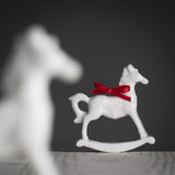 Christmas decoration, rocking horses, porcelain figurine Royalty Free Stock Photo