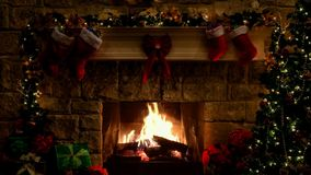 Christmas decoration of the room with the majestic fireplace in the center and marvelous christmas tree