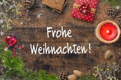 Christmas decoration and the German message for `Merry Christmas` royalty free stock photography
